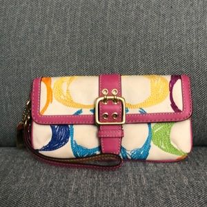 Coach wristlet, colorful with pink trim and strap